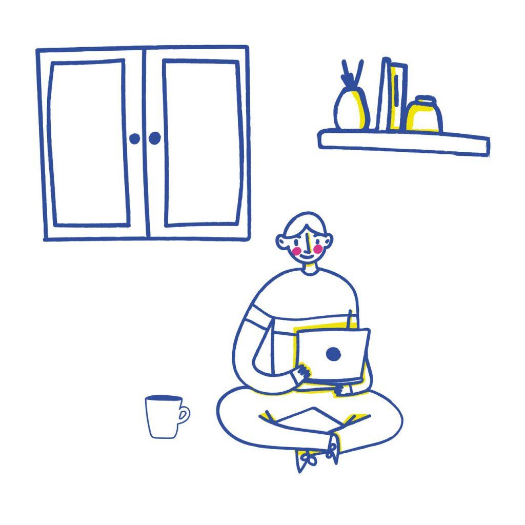 bir odada yalnız başına çalışan adam